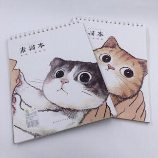 Skitseblokke med katte på forsiden
